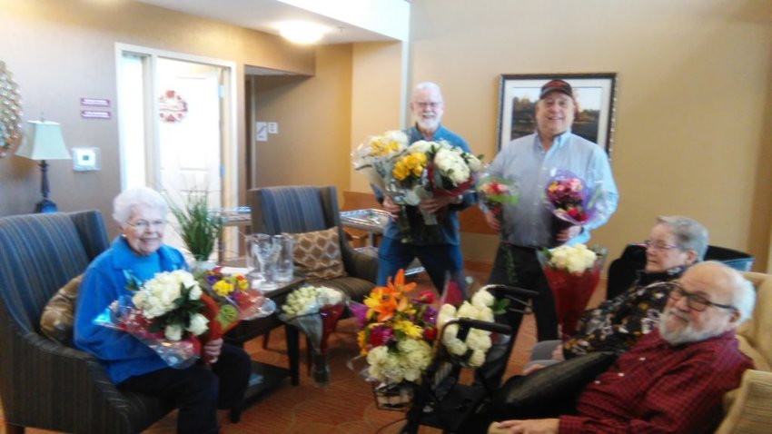 Mitchell Lallier delivers flowers on Valentine's Day
